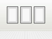 Three Vector Empty Blank White Mock Up Posters Pictures Black Frames on a Wall. Royalty Free Stock Photography