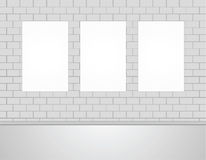 Three Vector Empty Blank White Mock Up Posters Pictures  on a Wall. Royalty Free Stock Image