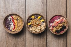 Three vegan and healthy fruits desserts on a wooden table royalty free stock images