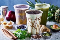 Three vegan smoothies with matcha, acia and guarana. On top of marble counter royalty free stock photography
