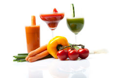 Three vegetable juices made of carrot, cucumber, tomato Royalty Free Stock Images