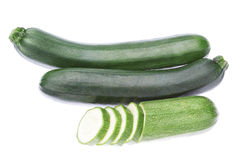 Three vegetable zucchini cut into pieces. Royalty Free Stock Image