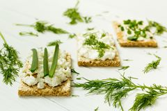 Three vegetarian breakfasts, toast, cottage cheese, onions and dill on a white wooden table, diet royalty free stock photography