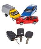 Three vehicle keys and model cars Royalty Free Stock Photo