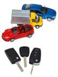 Three vehicle keys and model cars Stock Image