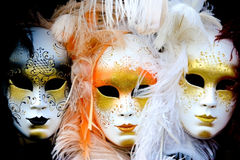 Three Venetian masks. Three angry looking caranaval masks - a popular souvenier from venice Stock Image