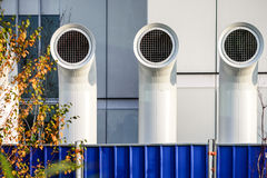 Three ventilation chimneys painted steel. Close up of three ventilation chimneys painted steel royalty free stock image