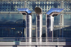 Three ventilation chimneys in stainless steel. Close up of three ventilation chimneys in stainless steel stock photography