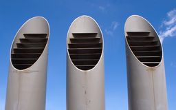 Three ventilation pipes over blue sky closeup Stock Photography