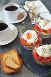 Three verrines breakfast. Poached eggs, tomatoes, zucchini and coffee Stock Photos