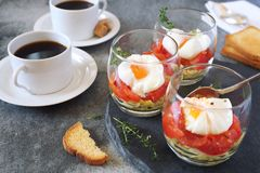 Three verrines breakfast. Poached eggs, tomatoes, zucchini and caps of coffee Royalty Free Stock Photography