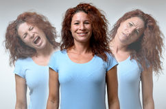 Three versions of woman in different moods. Front view on three versions of woman changing from moods of anger, joy and confusion Royalty Free Stock Photos