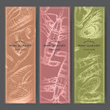 Three vertical banners with fish, shrimps, lobster, oysters silver sketches. Three vertical fish market banners with grilled fish, lobster, seafood silver Royalty Free Stock Image