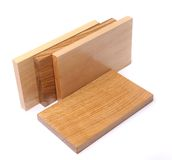 Three vertical boards (elm, acacia, lime). Ang one horizontal board (oak) on a white background Stock Images