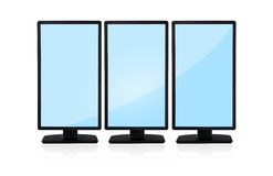Three vertical monitor Stock Photography