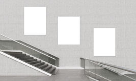 Three vertical posters and staircase. Royalty Free Stock Photography