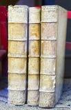 Three very old books standing Stock Photos