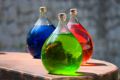 Three vesseles with colored liquid Royalty Free Stock Photos