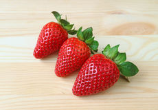 Three Vibrant Red Color Fresh Ripe Strawberry Fruits stock photos