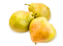 Three vibrant ripe pears with spotty pear skin on white. Stock Photography