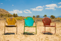 Three Vibrant, Vintage Charis Sitting Empty in the royalty free stock photos