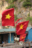 Three Vietnamese Flags. A trio of Vietnamese flags flying from a boat in a fishing village Royalty Free Stock Photo