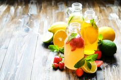 Summer healthy non alcoholic cocktails, citrus infused water drinks, lemonades with lime lemon or orange, diet detox beverages. royalty free stock photo