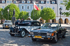 Vintage Saab, Adler and Mercedes parked. Old vintage Adler, Mercedes 380 SE and Saab 95 automobiles parked in Wejherowo market during old cars race in Northern Royalty Free Stock Image