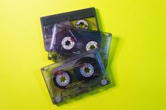Three vintage cassettes on a yellow background.  royalty free stock photography
