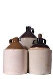 Three Vintage Ceramic Jugs. Grouping of three vintage ceramic jugs with white iso background Stock Photos
