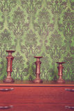 Three vintage chandeliers on green rococo style pattern backgrou Stock Photos
