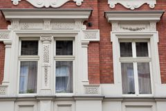 Three vintage design windows on the facade of the old house Royalty Free Stock Photos