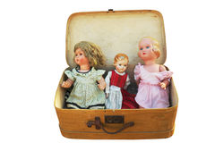 Three vintage doll in an old suitcase Royalty Free Stock Photos