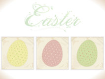 Three vintage Easter eggs on square panels Stock Photo