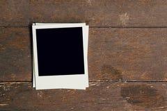 Three vintage frame photo blank on old wood background Stock Photos