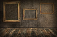 Three vintage frames on the wall. Stock Images