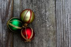 Vintage Christmas Ornaments on Distressed Background Stock Photo