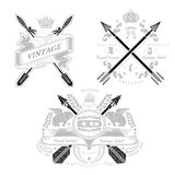 Three vintage heraldic element with cross arrows and decorative elements Stock Photos
