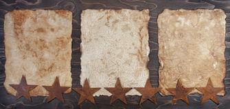 Three vintage papers with rusty stars Stock Image