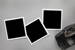 Three vintage photo frames with blank space for your content and old photo camera on gray table. Background stock photos