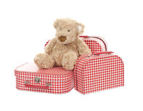 Three vintage red and white suitcases with teddy bear Stock Image