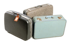 Three vintage suitcases. Three vintage hard-sided suitcases of different sizes and colors Royalty Free Stock Photos