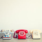 Three Vintage Telephones Stock Image