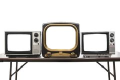 Three Vintage Televisions Isolated with Empty Screens. Three vintage televisions isolated on white with empty screens and clipping path Stock Photos