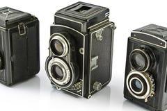 Three Vintage two lens photo cameras Royalty Free Stock Photo
