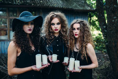 Three vintage women as witches Royalty Free Stock Image