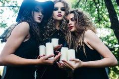 Three vintage women as witches Stock Photos
