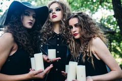 Three vintage women as witches Stock Image