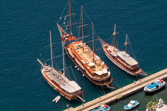 Three vintage wooden ships on Santorini island Royalty Free Stock Photo