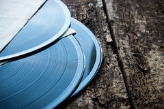 Three vinyl records on a wooden Stock Image